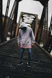 Man in Gray Pull-over Hoodie Standing on Train Rail Royalty Free Stock Photo