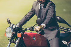 Man in Gray Suit Riding Red Bmw Motorcycle Royalty Free Stock Photography