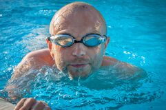 Man With Gray Swimming Goggles in Body of Water Stock Photo