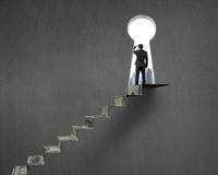 Man grazing with money stairs and key hole Royalty Free Stock Photo
