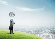 Man of great mind. Faceless businessman with drawn brain instead of head Stock Photography