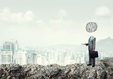 Man of great mind. Faceless businessman with drawn brain instead of head Royalty Free Stock Images