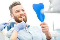 Man with great smile at the dental office Stock Image