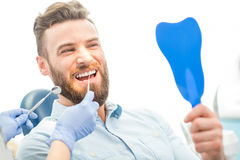Man with great smile at the dental office Stock Photography