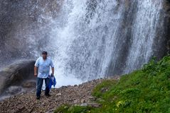 Man and great waterfall Royalty Free Stock Images