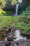 Man on a Great waterfall in Carpathian mountains. Royalty Free Stock Images