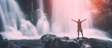 Man on a Great waterfall. Instagram stylization royalty free stock images