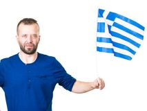 Man with greek waving flag, on white