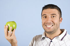 Man with green apple Stock Photography