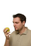 Man with green apple Stock Photo