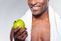 Man with green apple. Royalty Free Stock Photos
