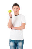 Man with green apple Stock Images