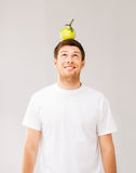 Man with green apple on his head Royalty Free Stock Images