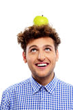 Man with green apple on his head Stock Photo