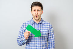 Man with green arrow pointing to the right and down Stock Images