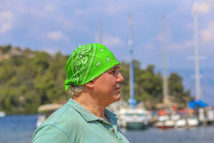 Man in green bandana Stock Photos