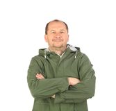 Man in green coat with crossed arms. Royalty Free Stock Images