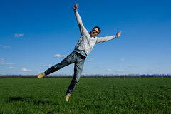 Man and green field Royalty Free Stock Image