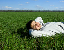 Man and green field Stock Photos