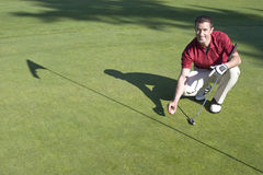 Man on Green of Golf Course - Horizontal Royalty Free Stock Photo