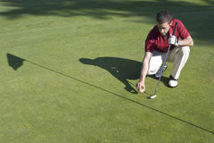 Man on Green of Golf Course - Horizontal Stock Image