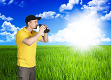Man and green grass field Royalty Free Stock Images
