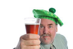 Man in a green hat with a beer Stock Photo