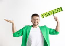 Food concept. Model holding a plate with letters of Protein royalty free stock image