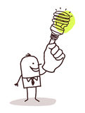 Man with green light bulb on finger Royalty Free Stock Images