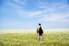 Man on green meadow. Stock Photo