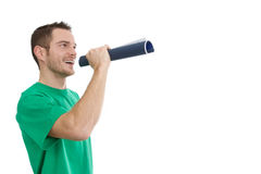 Man in green with megaphone - orator - isolated on white Royalty Free Stock Photography