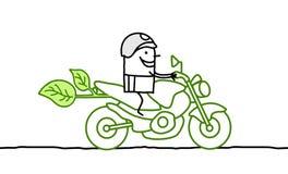 Man on green moto Stock Photo