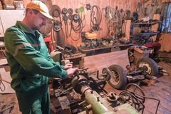 A man in a green overall in workshop royalty free stock images
