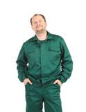 Man in green overalls Royalty Free Stock Photography