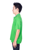 Man in green polo shirt isolated on white background side view Royalty Free Stock Image