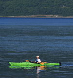 Man in Green Sea Kayak Stock Photo