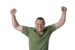 Man in green shirt. Male showing jubilant expression with both arms raised Royalty Free Stock Photography