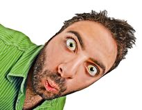 Man with green shirt with surprised expression WOW on white. Dragan effect.  royalty free stock images