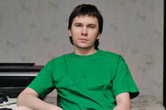 Man in green t-shirt. Stock Image