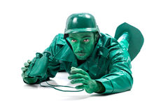 Man on a green toy soldier costume Stock Photography