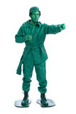 Man on a green toy soldier costume Stock Image