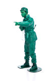 Man on a green toy soldier costume Stock Images