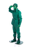 Man on a green toy soldier costume Royalty Free Stock Images