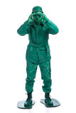 Man on a green toy soldier costume Royalty Free Stock Image