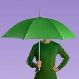 Man with green umbrella Royalty Free Stock Photo