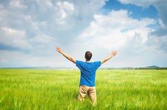 Man in green wheat meadow. Stock Image