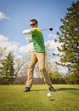Man in Green and White Stripes Long Sleeve Shirt Holding Black Golf Club Stock Photography