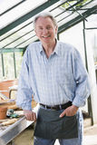 Man in greenhouse smiling Royalty Free Stock Images