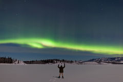 Man greeting Northern Lights Aurora borealis Royalty Free Stock Photos