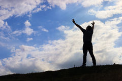 Man greeting sun concept of freedom Stock Images